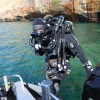 Underwater cameraman Dan Stevenson  prepares to dive cliffs of  Pictured Rocks,  Lake Superior <li><em> Crispin Sadler</em></li>