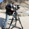 Wayne Abbott filming at eroding sand cliffs, Lake Erie<li><em>Crispin Sadler</em></li>