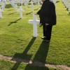 Barbara Shaw - Barbara Shaw at the grave of her grandfather Joseph Thibodeau, at American War Cemetery, Normandy.  NSE